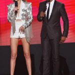 Gigi Hadid and Jay Pharoah onstage American Music Awards