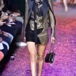 Model Gigi Hadid presents a creation for Elie Saab