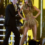 Rapper Pitbull and actress Sofia Vergara perform onstage