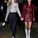 Gigi and Bella Hadid flashes her underwear in tiny leather coat