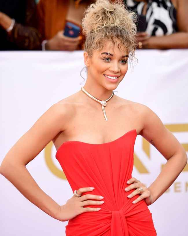 Jasmine Sanders' Curly Bun and Wispy Bangs